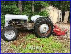 Massey Ferguson tractor with Finishing Mower, Box Blade, and Bucket attachments